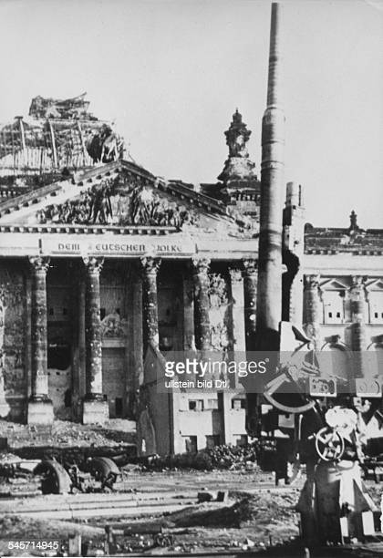 Germany Berlin Antiaircraft gun in front of the ruin of the Reichstag May 1945