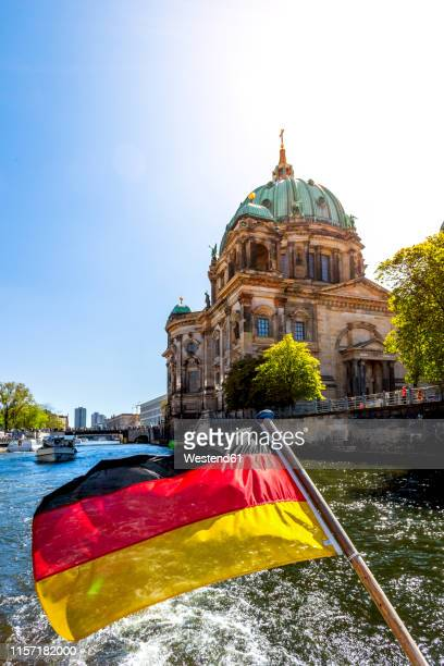 germany, berlin, berlin cathedral and german flag on excursion boat on river spree - ベルリン大聖堂 ストックフォトと画像