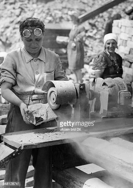 Germany Berlin Berlin Truemmerfrauen at work on a maschine cleaning the stones 1946 Photographer Walter Gircke Vintage property of ullstein bild