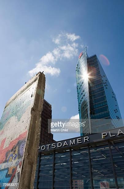 Germany, Berlin, Berlin Wall in front of modern skyscraper