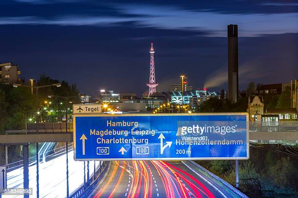 Germany, Berlin, Berlin-Charlottenburg, Federal Motorway 100 through downtown Berlin with the Funkturm Berlin and the exhibition halls in the background at night