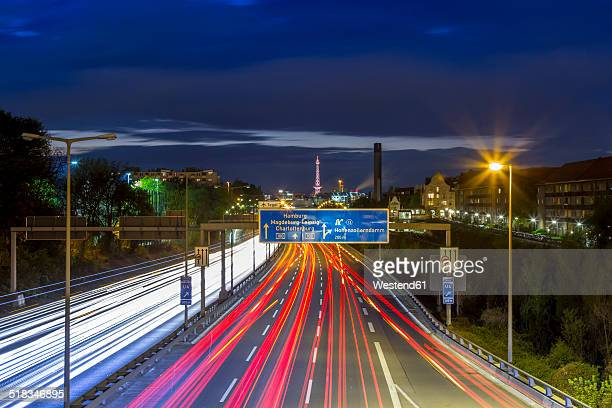 Germany, Berlin, Berlin-Charlottenburg, Federal Motorway 100 through downtown Berlin with the Funkturm Berlin in the background at night