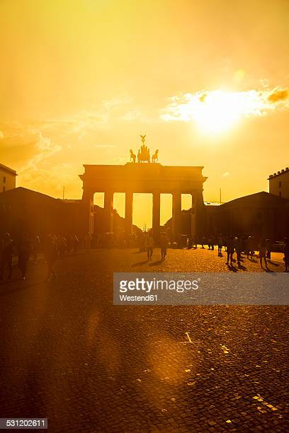 Germany, Berlin, Berlin-Mitte, Brandenburg Gate, Pariser Platz and tourists against the sun