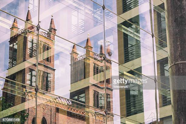 Germany, Berlin, Berlin-Mitte, Friedrichswerder Church mirrored in glass facade of Federal Foreign Office