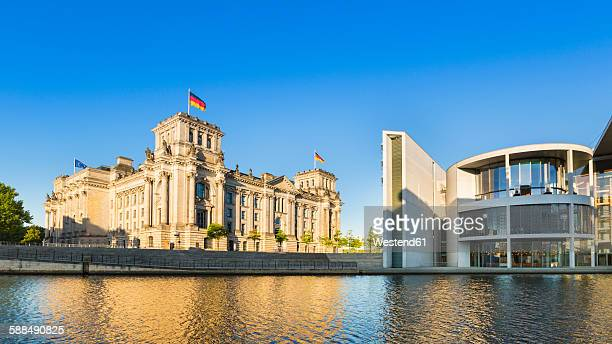 Germany, Berlin, Berlin-Tiergarten, Reichstag and Paul-Loebe building at the river Spree