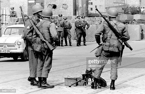 Germany Berlin bilding of the wall at Kreuzberg US soldiers and EastGerman boarder guards standing in front of each other at Sebastianstrasse /...