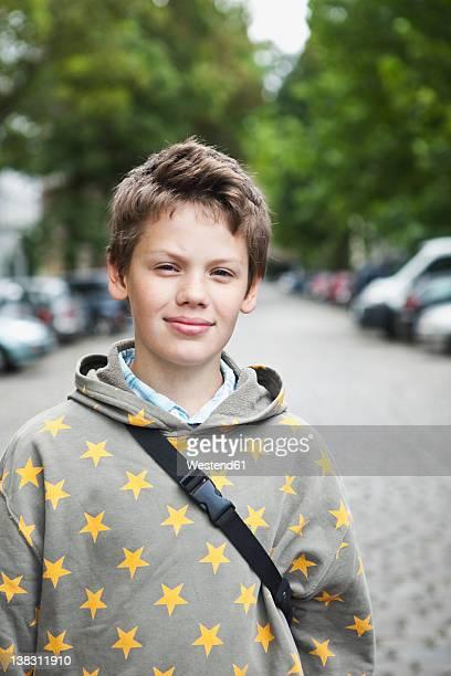 Germany, Berlin, Boy standing in street