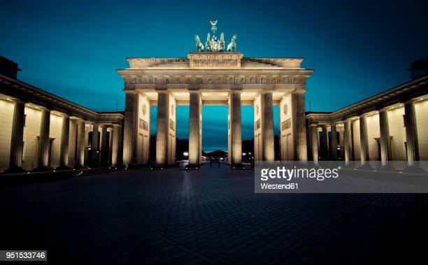 germany, berlin, brandenburg gate at night - berlin stock pictures, royalty-free photos & images