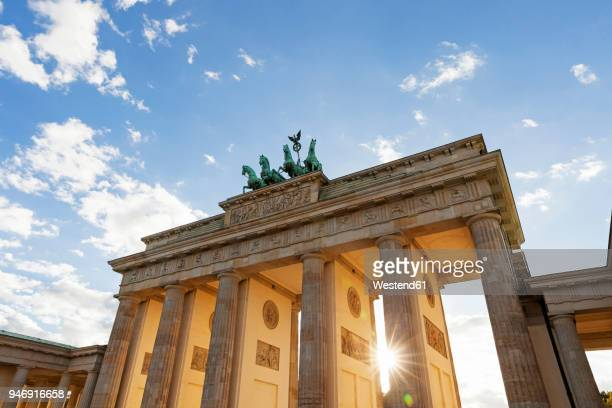 germany, berlin, brandenburger tor at back light - historical geopolitical location stock photos and pictures