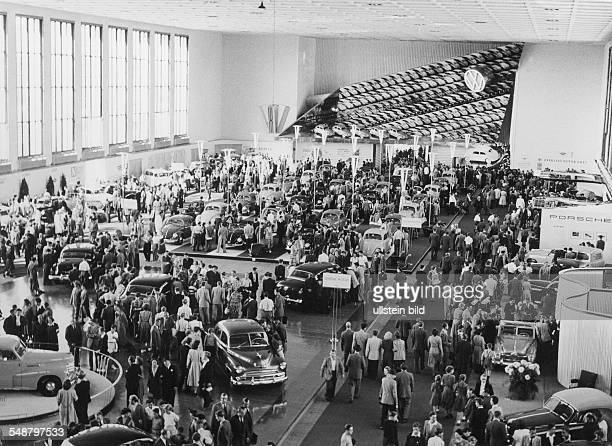 Germany Berlin British sector International Motor Show view of a fairground hall in which the VW Beetle is being advertised Photographer Martin...