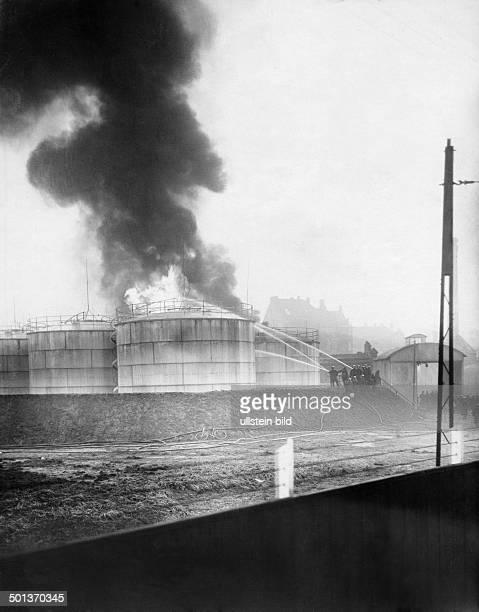 Germany Berlin burning petrol tanks firemen blowing out the fire date unknown