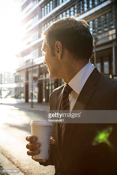 Germany, Berlin, Businessman holding coffee cup