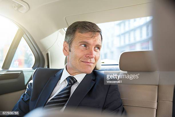 Germany, Berlin, Businessman in taxi