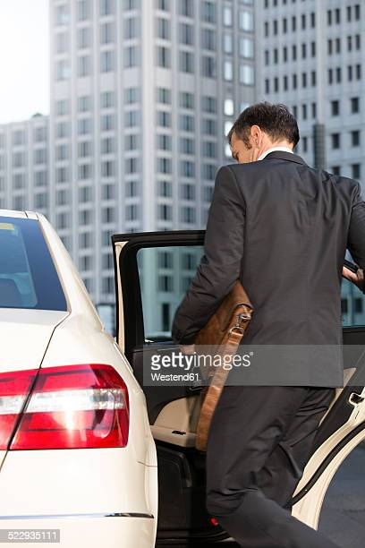 Germany, Berlin, Businessman taking a taxi