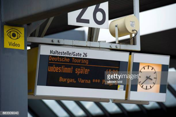 Germany Berlin Charlottenburg central bus station passengers at the ticket counter bus to Prag is delayed