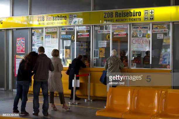 Germany Berlin Charlottenburg central bus station passengers at the ticket counter