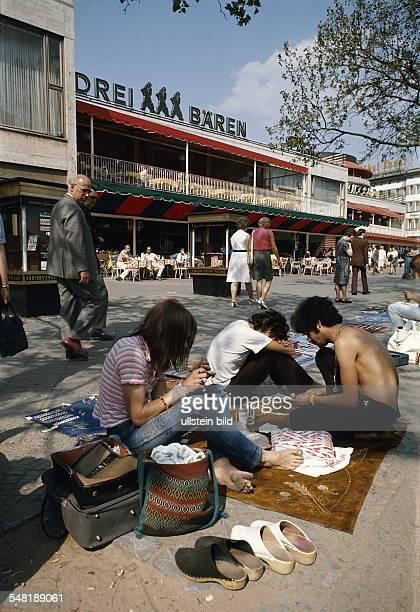 Germany Berlin Charlottenburg Street hawker producing trinketry at the boulevard 'Kurfuerstendamm' 1972