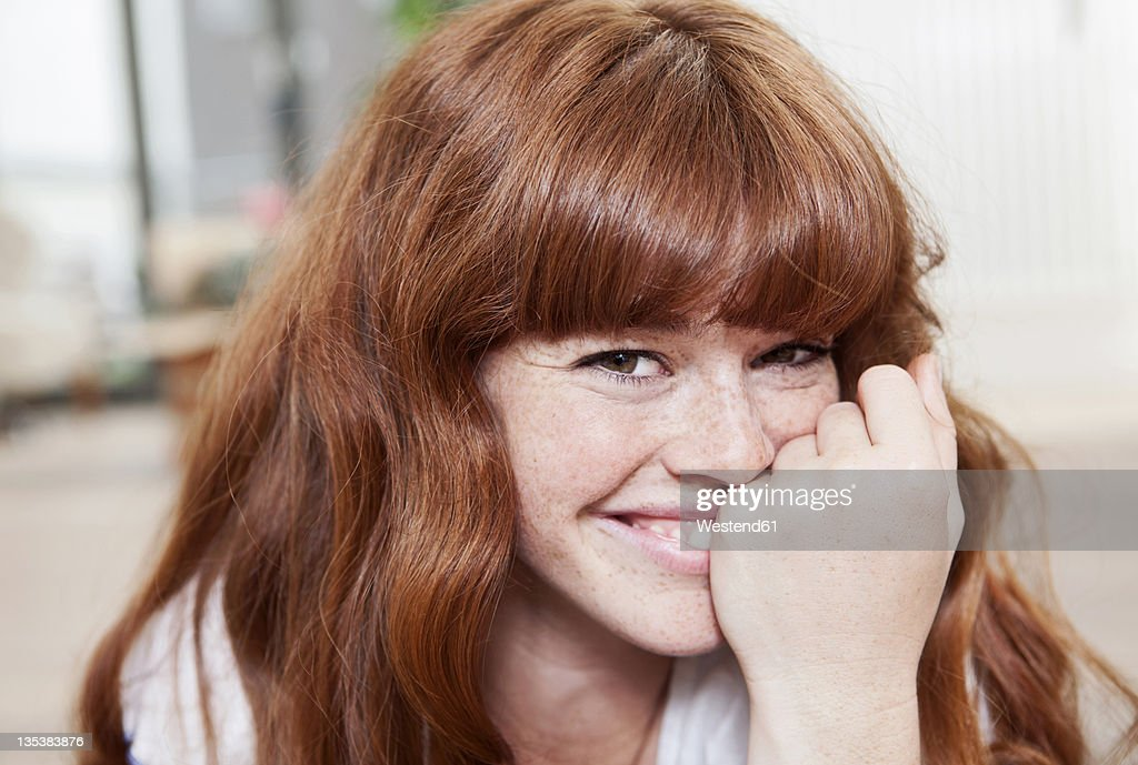 Germany, Berlin, Close up of young woman, smiling, portrait : Stock Photo