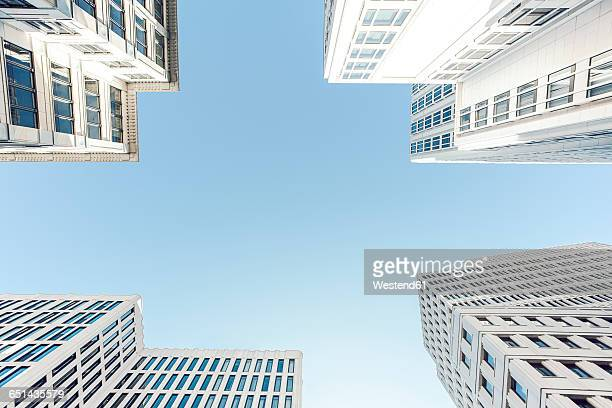 Germany, Berlin, facades of four skyscrapers at Potsdamer Platz seen from below