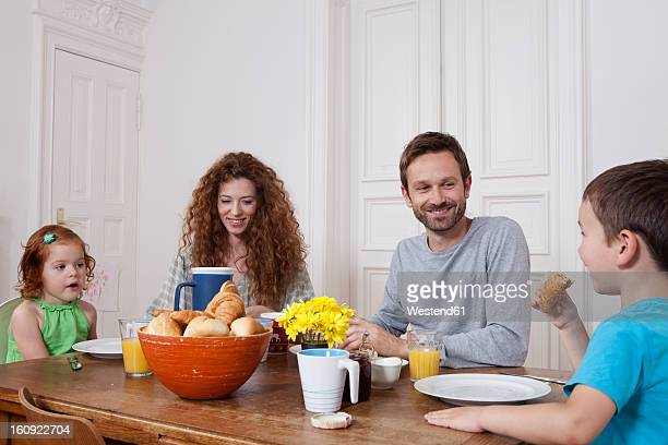 Germany, Berlin, Family having breakfast, smiling