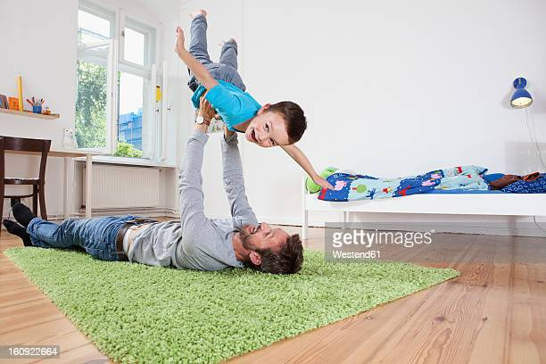 Germany, Berlin, Father holding son, smiling