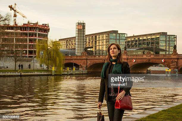 Germany, Berlin, female tourist on the move near central station