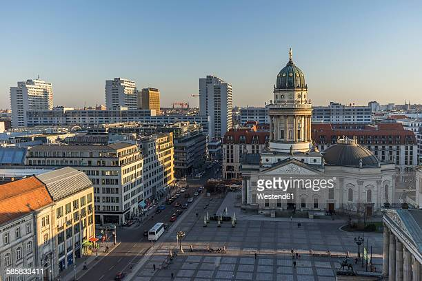 germany, berlin, franzoesischer dom and gendarmenmarkt at sunset - gendarmenmarkt stock photos and pictures
