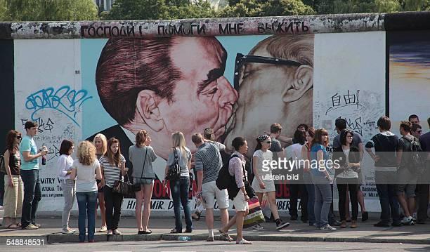 Germany Berlin Friedrichshain 'Der Bruderkuss' between Brezhnev and Honecker by Dmitry Vrubel on the former Berlin Wall at the East Side Gallery