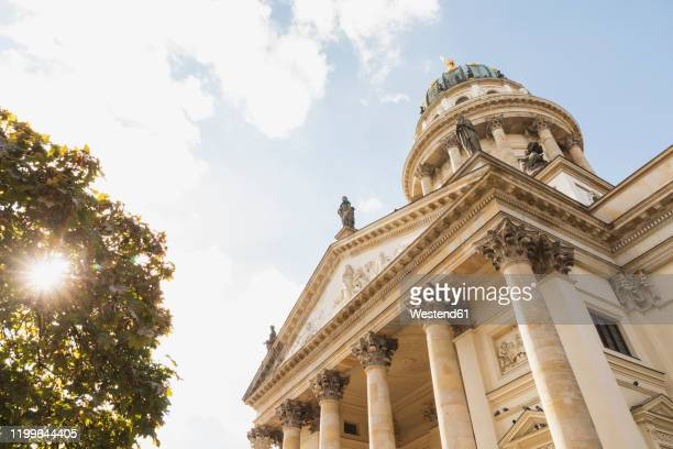 germany, berlin, gendarmenmarkt, low angle view of french cathedral - französischer dom stock pictures, royalty-free photos & images