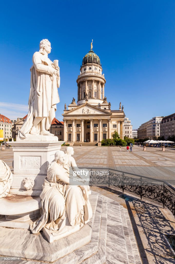 Germany, Berlin, Gendarmenmarkt, view to French Cathedral with statue of Friedrich Schiller in the foreground : ストックフォト
