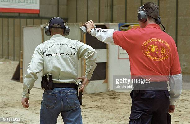 German championship of the International Practical Shooting Confederation Shooter with pistol in action Range officer cares July 15 2000
