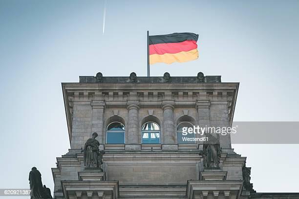 Germany, Berlin, German flag on Reichstag