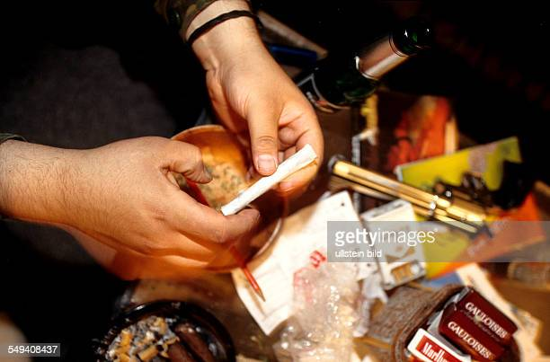 Germany, Berlin: Hip Hop in Berlin.- Kreuzberg; a turkish young person making a joint.