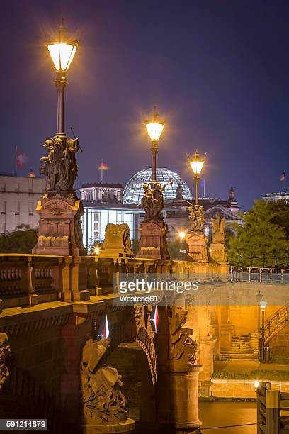 Germany, Berlin, historic bridge and Reichstag at night