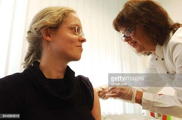 Germany Berlin - immunisation against swine flu with influenza vaccine Pandemrix of GlaxoSmithKline company -