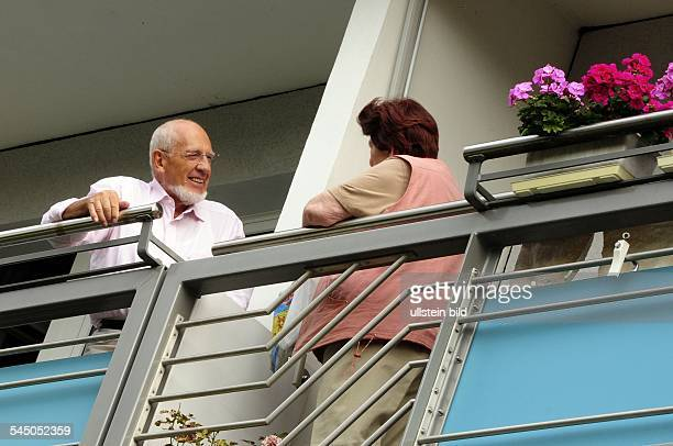 Germany Berlin Koepenick apartment house for elderly people of the housing society Degewo at Charlottenstrasse neighbours are talking from balcony to...