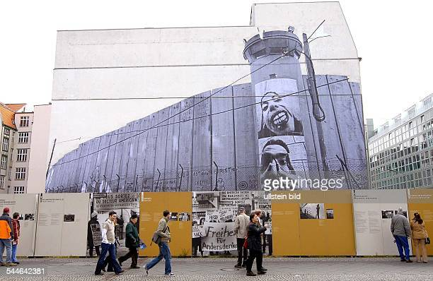 Germany Berlin Kreuzberg exhibition of large posters with portraits of Israelis und Palestinians by the french artist JR at Checkpoint Charlie in...