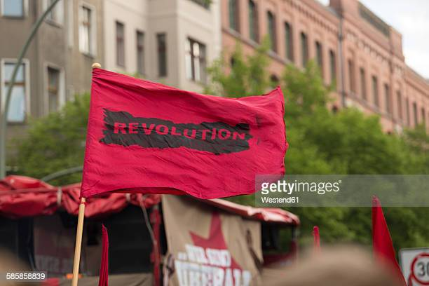 Germany, Berlin, Kreuzberg, red flag on demonstation on 1st of May