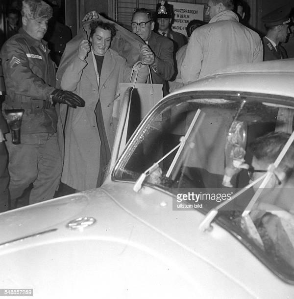 Germany Berlin Kreuzberg woman return to East Berlin at border crossing Friedrichstrasse