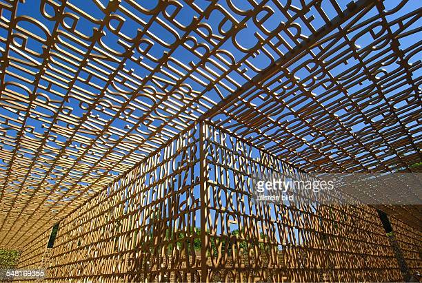 Germany Berlin Marzahn pleasure park Marzahn Gardens of the World Christian Garden colonnade made of brass is showing excerpts of the bible