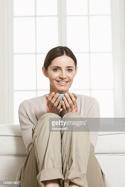germany, berlin, mature woman holding bowl, smiling, portrait - 7894 stock pictures, royalty-free photos & images