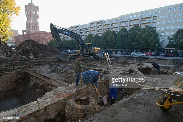 Germany Berlin Mitte archaeological excavations at MarxEngelsForum the city hall Rotes Rathaus in the background