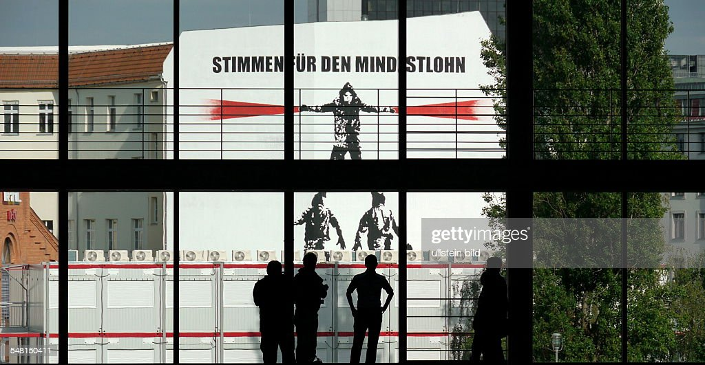 Minimum Berlin germany berlin mitte caign for minimum wages at a wall seen