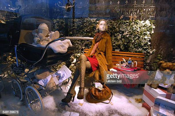Germany Berlin Mitte Christmas shopping in the department store KaDeWe on the first saturday in Advent season Christmas decoration in the shop window