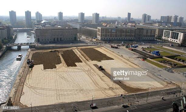 Germany Berlin Mitte filling up topsoil on the area of the former Palast der Republik