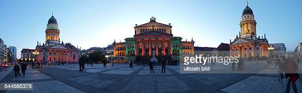 Germany Berlin Mitte he illuminated concert hall Konzerthaus am Gendarmenmarkt during the Festival of Lights left handed the church Deutscher Dom...