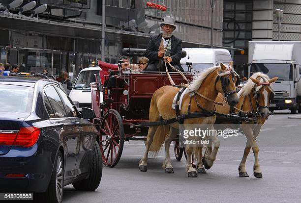 Germany Berlin Mitte - horse-drawn carriage at Friedrichstrasse -