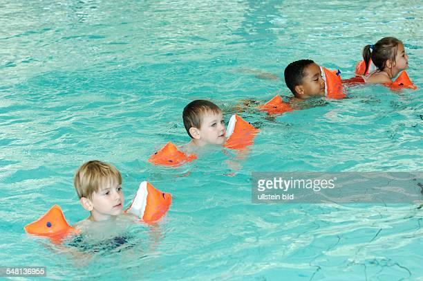 Germany Berlin Mitte indoor swimming pool on Fischerinsel children with water wings
