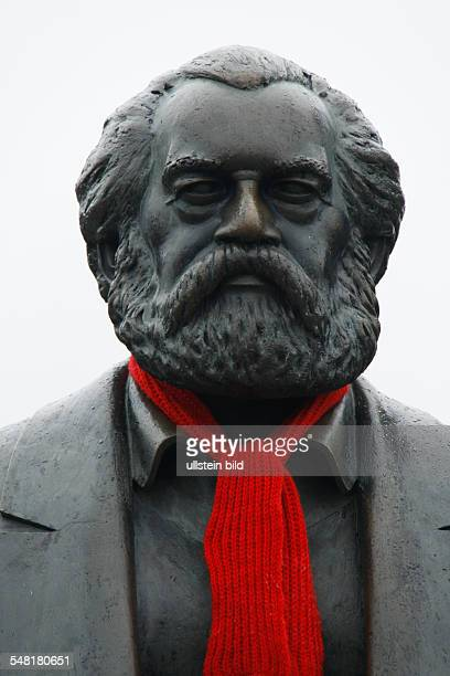 Germany Berlin Mitte Karl marx memorial with a red shawl at MarxEngelsForum