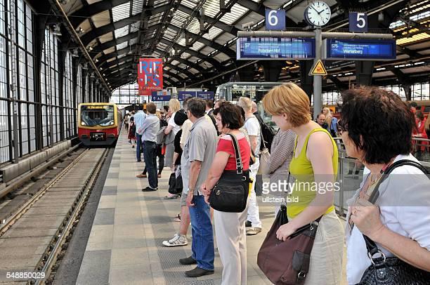 Germany Berlin Mitte passangers waiting on the platform of SBahn station Friedrichstrasse